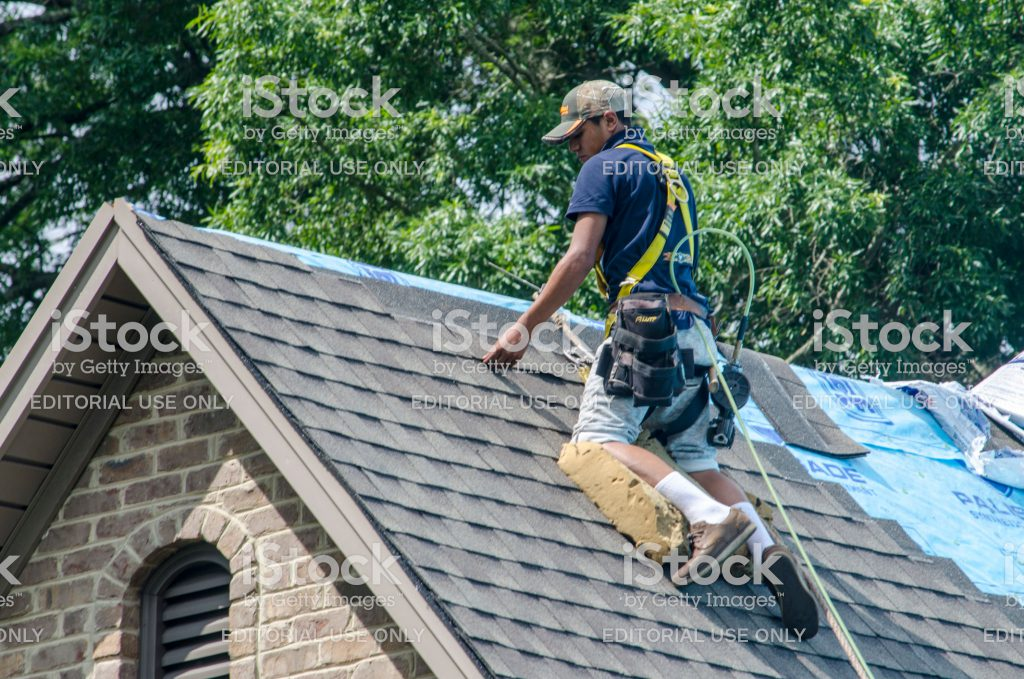Roofer on steep slope